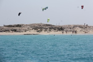 Kite-surfers, beaches and clear blue water at Isla Formentera