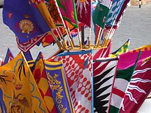 Flags of the different contrades  during the Siena Palio