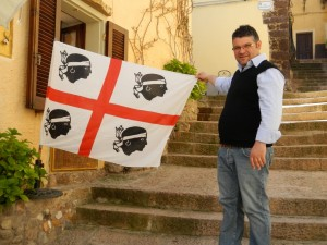The proud owner of the restaurant showing of the flag of Sardinia