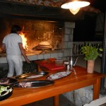 A chef in action in one of the outdoor restaurants in Polace